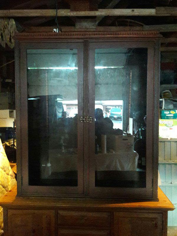 Dark wood/glass cabinet
