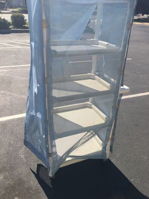 5 tier screened rolling cart. 2 locking wheels and 2 free wheels.! Very sturdy rolls good. All the sides are velcro attached and are removable for Sale in Fremont, CA