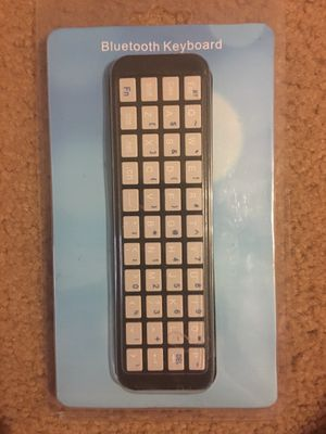 Ipazzport wireless keyboard remote holder for appletv 4th generation new in box for Sale in Weiner, AR