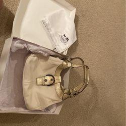 New Coach Handbag with Tag/ Original Box/ Original Storage Bag/ Off White with Gold Trim for Sale in Elk Grove,  CA