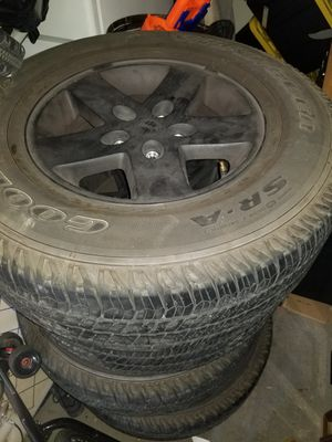 Jeep wrangler stock rims and tires for Sale in Las Vegas, NV