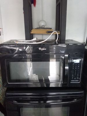 Black whirlpool over the range microwave bracket and screws included in excellent working condition for Sale in Kissimmee, FL