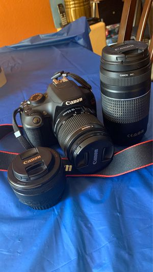 Canon RebelT5 with 18-55 kit lens, 50mm portrait lens, 75-300mm zoom lens and charger included for Sale in Salinas, CA