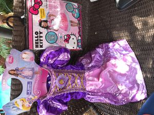 2 Girls 4+ HALLOWEEN COSTUMES RAPUNZEL AND HELLO KITTY for Sale in Glendale, AZ