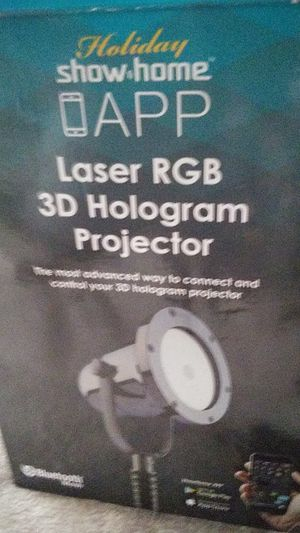 Holiday show home app holigram projector for Sale in Montrose, CO