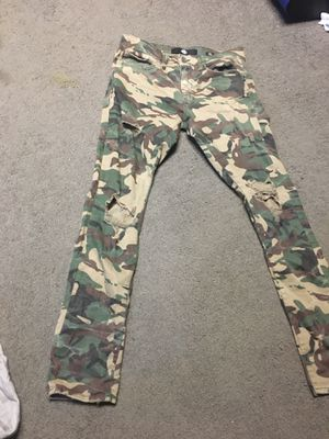 Fatigue jeans with the cuts for Sale in OXON HILL, MD