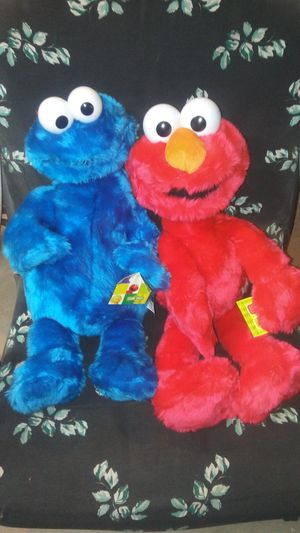 Brand new still have tags on them. Would make excellent christmas gifts Sesame Streets Cookie Monster and Elmo for Sale in Victorville, CA