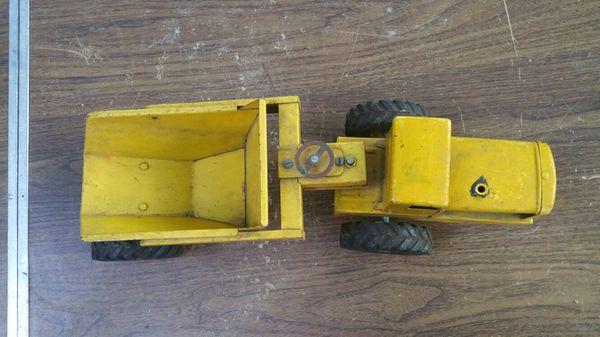 Vintage toy metal scraper