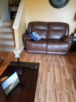 Brown Leather Recling Couch Set With Coffee Table  for Sale in Conyers, GA