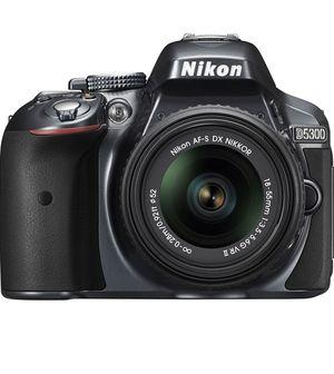 Nikon D5300 24.2 MP CMOS Digital SLR Camera with 18-55mm f/3.5-5.6G ED VR II AF-S DX NIKKOR Zoom Lens (Black) for Sale in Queens, NY