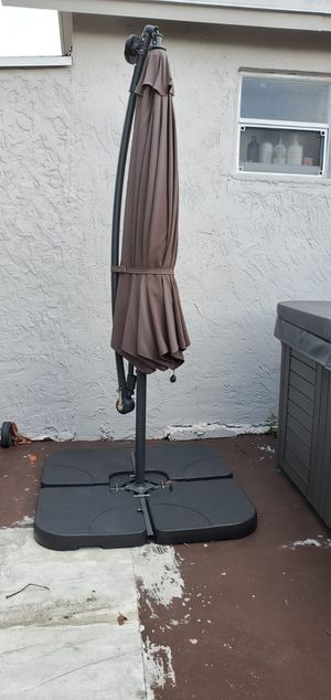 10-Foot Solar Patio Umbrella with Outdoor LED Lights Crank - Brown Polyester plus weighted base for Sale in Miami, FL
