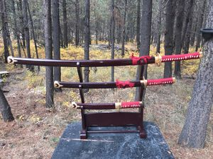 Three decorative swords on a stand for Sale in Bend, OR