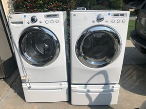 LG WASHER AND DRYER WITH DRAWER STANDS for Sale in Douglasville, GA