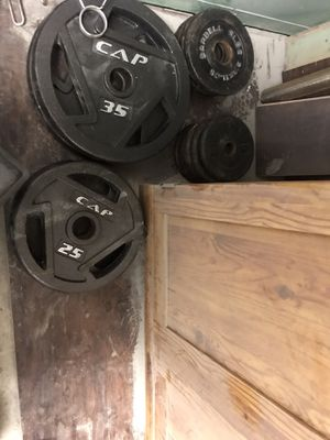 Olympic plates, bars and benches 25's 10's 5's 2.5's 1.50 per pound for Sale in Columbus, OH
