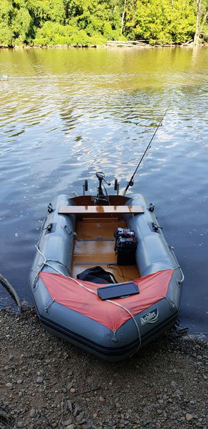 small inflatable boat electric motor and new battery for Sale in Springdale, MD