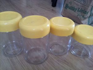 6 Vintage yellow top glass containers for Sale in San Diego, CA