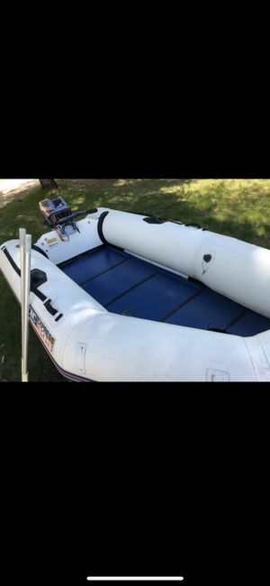 Boat zodiac inflatable dinghy 10' with trailer, motor for Sale in Kingsley, MI