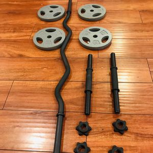 "40 lb cast iron weight plates plus 47"" curl bar and 14"" dumbbells handles for Sale in Anaheim, CA"