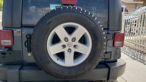 Jeep wheel and new tire for Sale in Las Vegas, NV