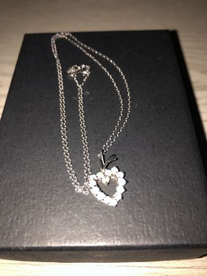 Authentic 14 k white gold diamond heart the chain is 18 k white gold for Sale in Fairfax, VA