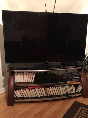 60 inch TV with stand for Sale in Tampa, FL