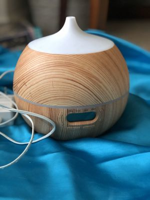 At home essential oils diffuser & slight humidifier wood panel style white spout plug in Preowned for Sale in Glen Ellyn, IL