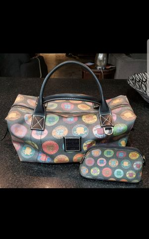 Dooney & Bourke Charcoal Black Multi Medallion Satchel Handbag with matching cosmetic bag for Sale in Mesa, AZ