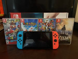 Nintendo Switch (Bundled with Zelda: Breath of the Wild, Super Mario: Odyssey, Mario and Rabbids: Kingdom Battle, Super Smash Bro's) for Sale in Fallsington, PA