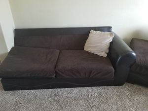 Sectional sofa half leather and half material. Chocolate and brown color in really good shape for Sale in Colorado Springs, CO