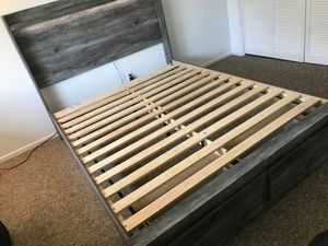 Ashley Furniture Gray Queen Size Bed Frame with 2 Drawers for Sale in Garden Grove, CA