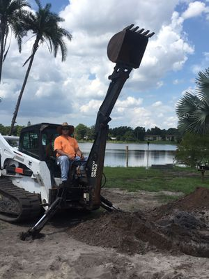 Used Bradco 9MD2 Backhoe Attachment w/ Fold Down Stabilizers for Sale in Lockhart, FL