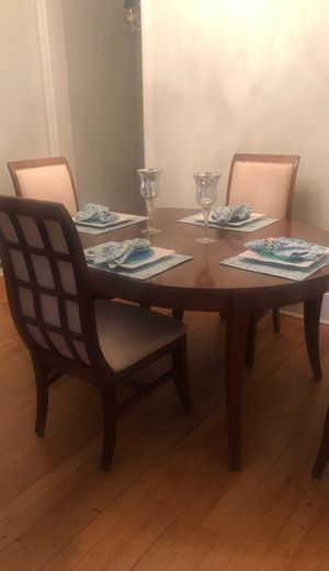 Solid wood dining room table with 2 leafs and 6 chairs and buffet. for Sale in Pensacola, FL