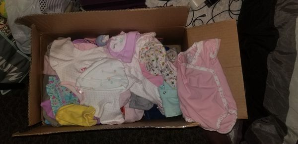 Box of baby clothes,girls and boys shoes.