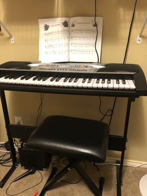 Keyboard and stool, music book and microphone. Barely used, in perfect condition. Includes stand, for pickup only, $75 for Sale in Round Rock, TX