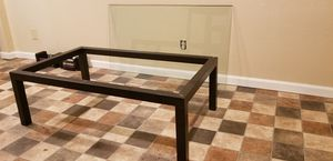 Crate and barrel black metal base coffee table with heavy glass top. for Sale in Peoria, IL