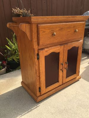Custom Made Solid Oak Cabinet - Has lots of Storage Below- On wheels with drawer & Amber Glass Doors! Excellent Condition! **Read Description** for Sale in La Puente, CA