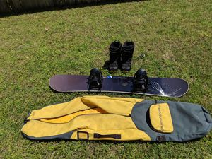 Burton Snowboard with Ride LX Bindings, Burton Travel Bag, and Saloman Boots for Sale in Highland Village, TX