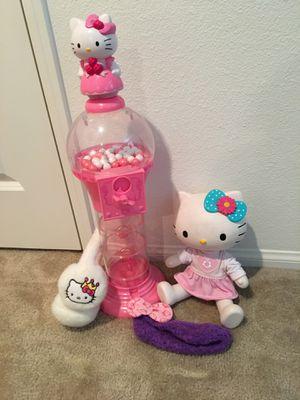 Hello Kitty Gum-ball machine, doll, beanie and ear muffs for Sale in Etiwanda, CA