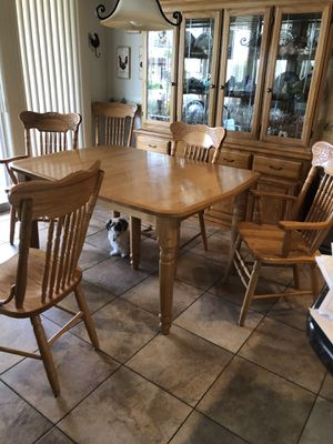 Solid oak table and chairs for Sale in Buckeye, AZ