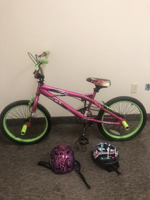 20 inch girls bike with bmx pegs 2 helmets for Sale in Cleveland, OH