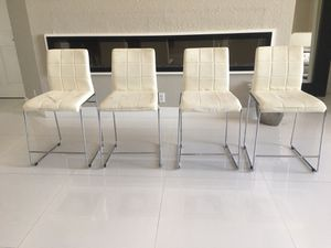 Four modern white chairs - has wear - price for all for Sale in Pembroke Pines, FL