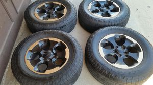 "Wheels and tires 18"" 5 lug jeep wrangler for Sale in Riverside, CA"