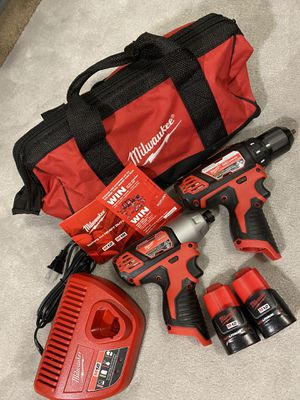 Milwaukee M12 12-Volt Lithium-Ion Cordless Hammer Drill/Impact Driver Combo Kit (2-Tool) W/(2) 1.5Ah Batteries, Charger & Bag for Sale in Seattle, WA