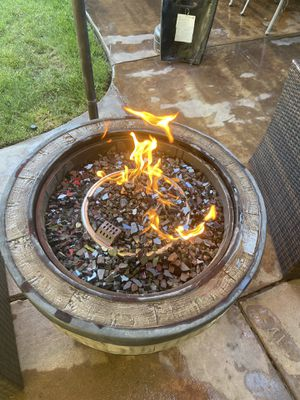 Beautiful four piece Fire pit table sit in excellent condition basically brand new $445 firm on the price serious buyers only please for Sale in Fresno, CA