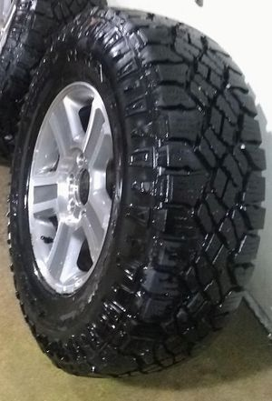 Near New All trrerrian tires and rims off of a 2004 ford expedition 6 Lug. Size 265/R17 for Sale in Colorado Springs, CO