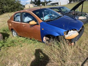 Orange 2005 and Blue 2004 Chevy Aveo parts car for Sale in Haines City, FL