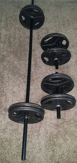 Weights metal 100lbs. 6x10lbs, 8x5lbs, 5 foot straight bar and 2 dumbbell bars. 6 weight lock clips. for Sale in Coconut Creek, FL