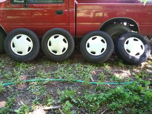 5 lug toyota tires+ rims + covers +good tred for Sale in Talent, OR
