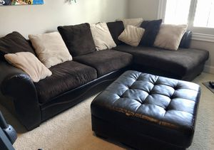Faux leather and fabric sectional couch and ottoman for Sale in Redmond, WA