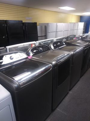 Whirlpool electric top load set washer and dryer in exellent condition for Sale in McDonogh, MD